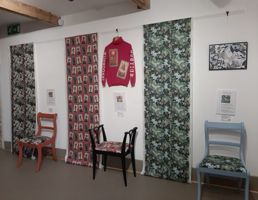 Image showing the three winning design on display in an exhibiiton at the Weavers Factory