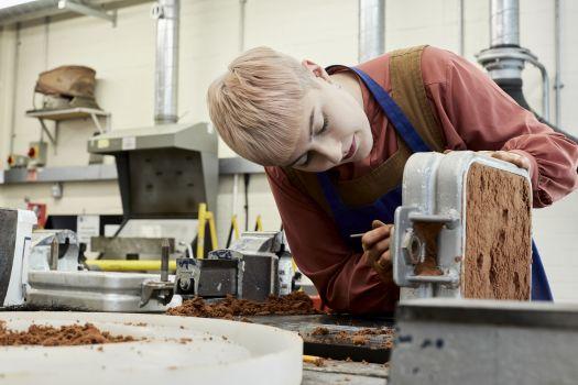 Harriet working in our metalwork workshop