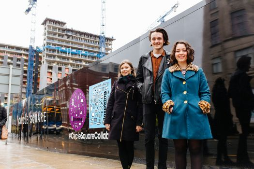 Students with Bruntwood hoardings