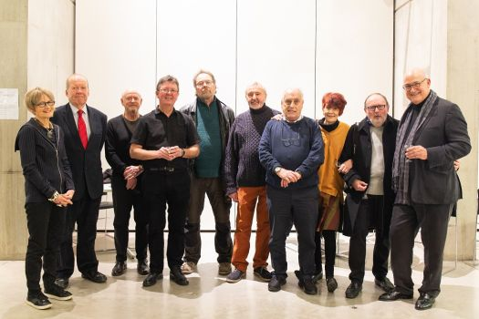 A group of Manchester School of Art alumni from 1969 who gathered for a 50th anniversay exhibition in the Benzie Building